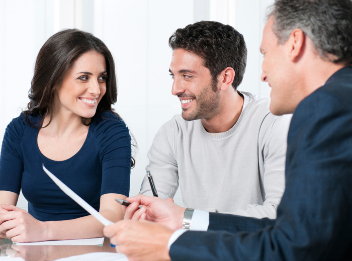 smiling couple in planning meeting with officiant